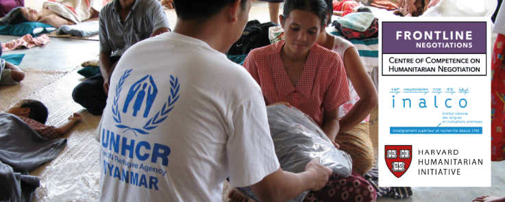 UNHCR Aid Worker Distributes Blankets to Cyclone Survivors